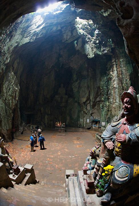 Marble Mountains. Thuy Son (Water Mountain). Huyen Khong Cave. Mandarin guard.