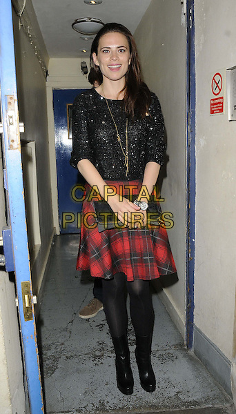 Hayley Atwell<br /> departed after the evening performance of &quot;The Pride&quot;, Trafalgar Studios, Whitehall, London, England.<br /> September 10th, 2013<br /> full length black  sparkly top red kilt check plaid tartan skirt tights clutch bag boots gold necklace <br /> CAP/CAN<br /> &copy;Can Nguyen/Capital Pictures