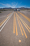 Barrier paint test patterns on an abandoned paved highway in Nevada.