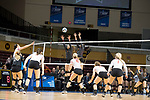 GRAND RAPIDS, MI - NOVEMBER 18: Maddie Fischer (18) of Wittenberg University taps the ball over the net past Shelbi Stein (3) and Melanie Moore (17) of Claremont-Mudd-Scripps during the Division III Women's Volleyball Championship held at Van Noord Arena on November 18, 2017 in Grand Rapids, Michigan. Claremont-M-S defeated Wittenberg 3-0 to win the National Championship. (Photo by Doug Stroud/NCAA Photos via Getty Images)