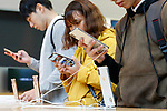 People test the new iPhone XS and iPhone XS Max at the Apple Store in Omotesando on September 21, 2018, Tokyo, Japan. Apple fans lined up patiently in the early morning rain to get the new iPhone models (XS and XS Max) and the new iWatch (Series 4). The new iPhone XS costs JPY 112,800 for the 64 GB model, the iPhone XS Max costs JPY 124,800 JPY for the 64 GB model, and iWatch Series 4 costs JPY 45,800. (Photo by Rodrigo Reyes Marin/AFLO)