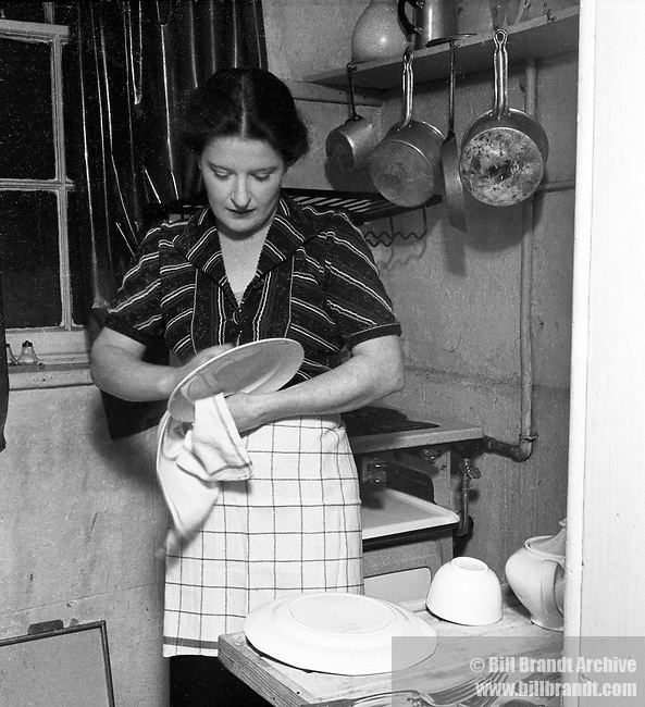 Cleaning the  dishes 1940s