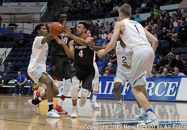 February 8, 2017:  New Mexico guard, Elijah Brown #4, fights to control a loose ball during the NCAA basketball game between the New Mexico Lobos and the Air Force Academy Falcons, Clune Arena, U.S. Air Force Academy, Colorado Springs, Colorado.  New Mexico defeats Air Force 74-67.