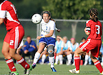 BROOKINGS, SD - AUGUST 16:  Diana Potterveld #7 from South Dakota State University passes the ball past Laura Carroll #3 from Winnipeg in the first half of their game Friday evening at Fischback Soccer Field in Brookings. (Photo by Dave Eggen/Inertia)