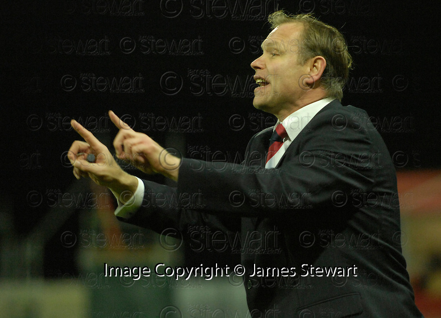 16/12/2006       Copyright Pic: James Stewart.File Name :sct_jspa17_falkirk_v_hibernian.JOHN HUGHES SHOUTS HIS INSTRUCTIONS.....James Stewart Photo Agency 19 Carronlea Drive, Falkirk. FK2 8DN      Vat Reg No. 607 6932 25.Office     : +44 (0)1324 570906     .Mobile   : +44 (0)7721 416997.Fax         : +44 (0)1324 570906.E-mail  :  jim@jspa.co.uk.If you require further information then contact Jim Stewart on any of the numbers above.........