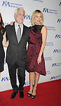 BEVERLY HILLS, CA- OCTOBER 23: Actress Sienna Miller (R) and Co-Chairman of Lionsgate Motion Picture Group Rob Friedman arrive at the International Medical Corps' Annual Awards dinner ceremony at the Beverly Wilshire Four Seasons Hotel on October 23, 2014 in Beverly Hills, California.