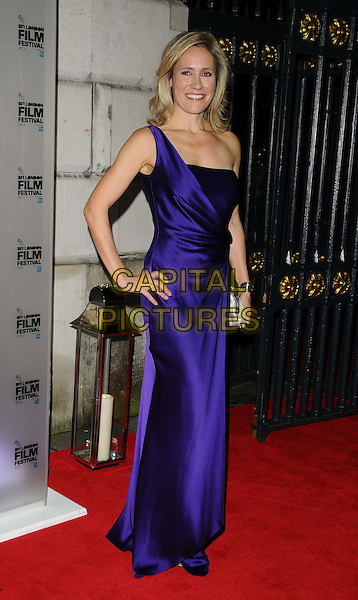Sophie Raworth<br /> attended the BFI London Film Festival Awards 2013, 57th BFI London Film Festival day 11, Banqueting House, Whitehall, London, England, UK, 19th October 2013.<br /> full length blue purple silk satin dress hand on hip one shoulder strap <br /> CAP/CAN<br /> &copy;Can Nguyen/Capital Pictures