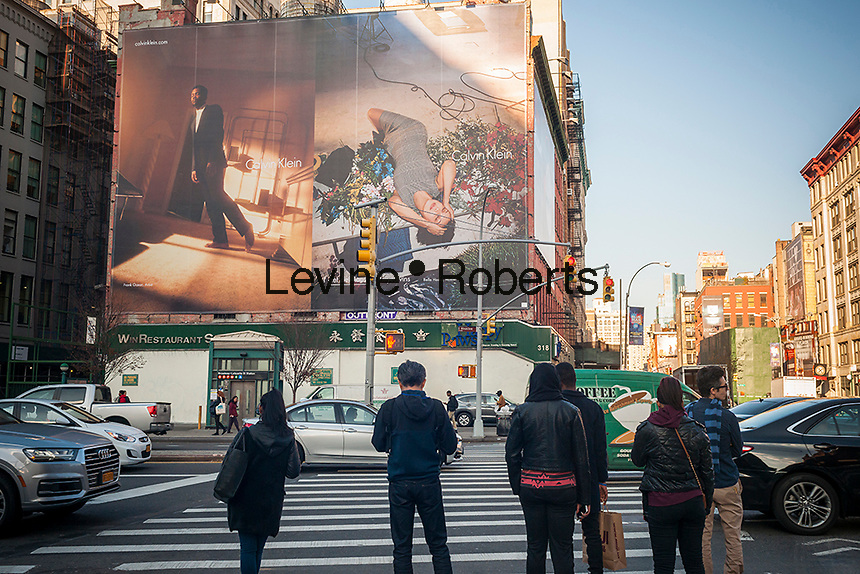 A billboard advertising the Calvin Klein brand featuring model Bella Hadid and artist Frank Ocean in the Soho neighborhood of New York on Thursday, November 17, 2016. Klein's advertisements use sex and provocative images to test society's cultural and moral boundaries. (© Richard B. Levine)
