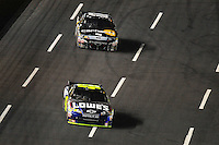 Oct. 17, 2009; Concord, NC, USA; NASCAR Sprint Cup Series driver Jimmie Johnson (48) leads Matt Kenseth during the NASCAR Banking 500 at Lowes Motor Speedway. Mandatory Credit: Mark J. Rebilas-