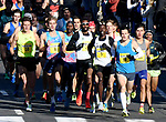 The elite runners as they had down Main Street to Charter Oak Street at the start of the race, during the 81st running of the Manchester Road Race, Thursday, November 23, 2017, in  Manchester. (Jim Michaud / Journal Inquirer)