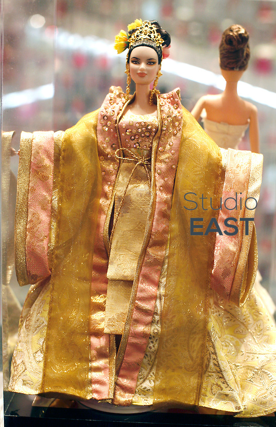 A Barbie doll dressed in an Asian outfit is on display in Barbie giant store in Shanghai, China, on March 6, 2009. Shanghai now boasts the world's biggest Barbie store after its six-storey pink palace opened on March 6. The $A44 million store's opening coincides with Barbie's 50th birthday. The doll's makers, Mattel, insist it will capture the imagination not just of young girls but of Chinese women of all ages, with more than 1600 products for sale. For younger girls, the store offers a catwalk on which they can model Barbie-esque clothes and assistants to teach them how to sing and dance to the Barbie Girl song. The Shanghai store is a crucial step in Mattels efforts to make China the number one market for Barbie dolls, while Chinese sales currently account for about 2.5 per cent of global sales. Photo by Francois Dorleans/Pictobank