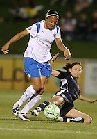 Homare Sawa #10 of the Washington Freedom slide tackles Angela Hucles #16 of the Boston Breakers during a WPS match at the Maryland Soccerplex, in Boyd's, Maryland, on April 18 2009. Breakers won the match 3-1.