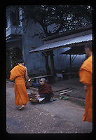 Monks begging alms in early morning