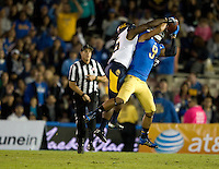 Michael Lowe of California fights for the ball in the air against Jordan Payton of UCLA during the game at Rose Bowl in Pasadena, California on October 12th, 2013.   UCLA defeated California, 37-10.