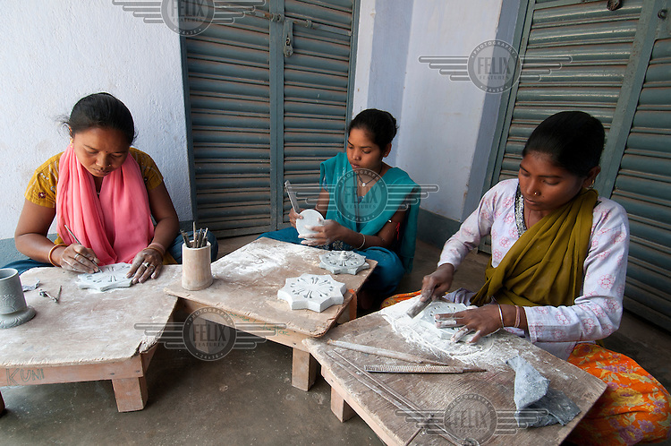 Girls from the Ho tribal group have been trained in soap stone carving. A cottage industry iniatative by TCS (Tribal Culture Society of Tata Steel). During their training period they are paid 100 rupees a day, later they earn according to their production.
