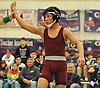 Jordan Soriano of Clarke raises his arm after his victory at 106 pounds over Vinny Butrico of Island Trees in the Nassau County Division II varsity wrestling finals at Cold Spring Harbor High School on Saturday, Feb. 10, 2018.
