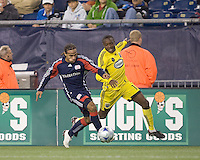 New England Revolution defender Kevin Alston (30) moves down wing as Columbus Crew midfielder Emmanuel Ekpo (17) defends. The Columbus Crew defeated the New England Revolution, 1-0, at Gillette Stadium on October 10, 2009.