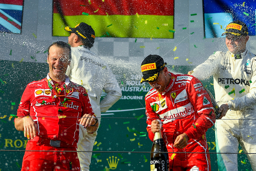 March 26, 2017: Luigi Fraboni and Sebastian Vettel (DEU) #5 from the Scuderia Ferrari team celebrate their win at the 2017 Australian Formula One Grand Prix at Albert Park, Melbourne, Australia. Photo Sydney Low
