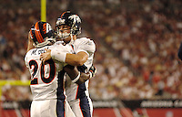 Aug. 31, 2006; Glendale, AZ, USA; Denver Broncos quarterback (6) Jay Cutler celebrates with running back (20) Mike Bell after a touchdown against the Arizona Cardinals at Cardinals Stadium in Glendale, AZ. Mandatory Credit: Mark J. Rebilas