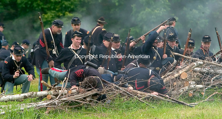 GOSHEN, CT--17 JUNE 2006 -061706JS30- Union troops engage the Confederate soldiers during the 'Battle at Wadham's Grove during the Civil War encampment in Goshen. The reenactment depicts the Jackson Valley Campaign.  -- Jim Shannon Republican-American