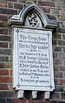 Memorial stone plaque commemorating Charles Fuge Lowder outside St Peter's London Docks Church in Wapping, London
