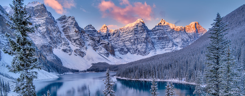 Sunrise and first snow of the season on Moraine Lake. Banff National Park, Alberta, Canada