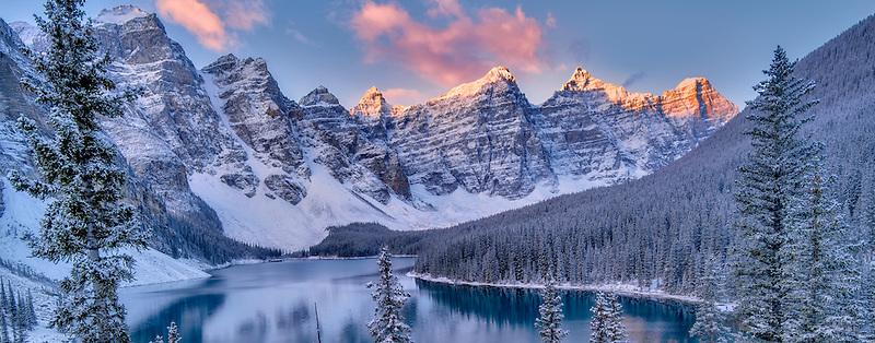 Sunrise and first snow of the season on Moraine Lake. Banff National Park, Alberta, Canada