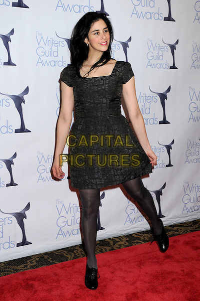 SARAH SILVERMAN .WGA 2009 Writers Guild Awards at the Hyatt Regency Century Plaza Hotel, Century City, CA, USA, .07 February 2009. .full length black dress hands in pockets lace-up shoes booties leg up .CAP/ADM/BP.©Byron Purvis/Admedia/Capital PIctures