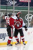 Mike Szmatula (NU - 19), Braden Pimm (NU - 14) - The Northeastern University Huskies defeated the University of Massachusetts Lowell River Hawks 4-1 (EN) on Saturday, January 11, 2014, at Fenway Park in Boston, Massachusetts.