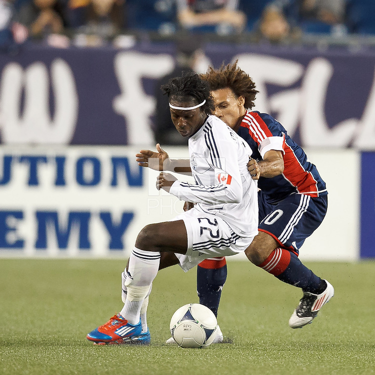 Vancouver Whitecaps FC forward Darren Mattocks (22) dribbles as New England Revolution defender Kevin Alston (30) defends. In a Major League Soccer (MLS) match, the New England Revolution defeated Vancouver Whitecaps FC, 4-1, at Gillette Stadium on May 12, 2012.