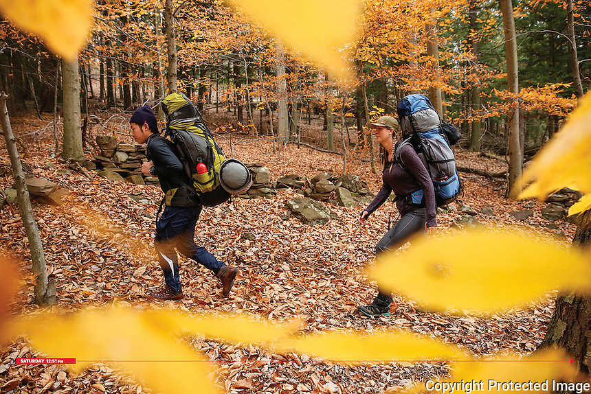 Ten students in a hiking and backpacking course trek three miles carrying 40-pound packs at SUNY Oneonta&rsquo;s 284-acre College Camp. Accompanied by Health and Fitness Department Lecturers Joel Skinner and Libby Bernard, the students learned about knot tying, water purification, group dynamics and leadership during the overnight trip.<br />