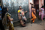 Asia, Bangladesh October 2012: .sex workers waiting for clients in front of their rooms..There is a brothel in Bangladesh that services 3,000 men a day. Sixteen hundred women live and work there.  Daulatdia, the biggest brothel in Bangladesh October 2012.  ©GIULIO DI STURCO
