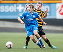 Queen of the South's Daniel Carmichael gets away from Alloa's Jonathan Tiffoney.