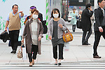 March 8, 2013, Tokyo, Japan :  Two women are seen wearing protective face masks in downtown Tokyo. Hay Fever and pollution cloud form China hit Japan. In Tokyo, and throughout Japan, Spring is the Hay fever season. Hay fever, or Kafunsho, is most commonly caused by pollen from Cryptomeria and Japanese Cypress, two native Japanese tree species. Japan is particularly subject to hay fever due to the great number of Cryptomeria and Japanese Cypress tree reforestation in the 70s, where these species were important resources for the construction industry. This year the hay fever season is also influenced by the Asian Dust, a flow of dust and pollution brought to Japan from China by strong westerly winds. (Photo by Yohei Osada/AFLO)