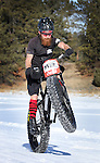 DEADWOOD, SD - JANUARY 23, 2016 -- Josh Bruhn #139 wheelies in the men's open class of the fat tire bike race at the 2016 Snow Jam Points Series at Tomahawk Country Club south of Deadwood, S.D. Saturday. (Photo by Richard Carlson/dakotapress.org)