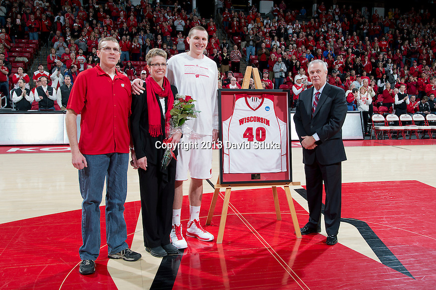 Wisconsin Badgers senior Jared Berggren (40) with his parents and Head Coach Bo Ryan prior to a Big Ten Conference NCAA college basketball game against the Purdue Boilermakers Sunday, March 3, 2013, in Madison, Wis. Purdue won 69-56. (Photo by David Stluka)