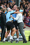 Graham Alexander manager of Scunthorpe Utd (r) celebrates what he thought was the winning goal during the English League One match at Glanford Park Stadium, Scunthorpe. Picture date: September 24th, 2016. Pic Simon Bellis/Sportimage