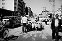 Turquie 1998.La rue principale de Dogubayazit..Turkey 1998.The main street of Dogubayazit with cars, people and a shepherd with his flock