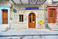The post office decorated with the famous geometric scratch patterns in the medieval mastic village of Pyrgi on the island of Chios, Greece