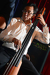 Boplicity, Tainan -- Samuel Liu, leader and bassist of Smalls Jazz Combo, performing on stage.