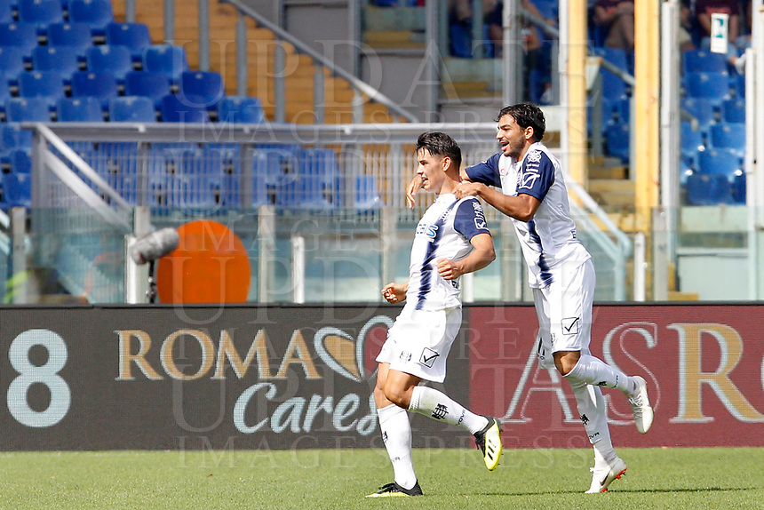 Chievo Verona's Mariusz Stepinski, left, is hugged by his teammate Mehdi Leris after scoring the equalizer goal during the Italian Serie A football match between Roma and Chievo Verona at Rome's Olympic stadium, September 16, 2018. The game ended 2-2<br /> UPDATE IMAGES PRESS/Riccardo De Luca