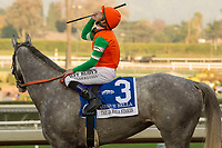 ARCADIA, CA  DECEMBER 26: #3 Unique Bella, ridden by Mike Smith,return to the connections after winning the La Brea Stakes (Grade l), on December 26, 2017, at Santa Anita Park in Arcadia, CA. (Photo by Casey Phillips/ Eclipse Sportswire/ Getty Images)