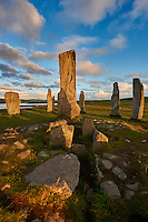 Central stone ring and monolith, erected around 2900BC, of the Calanais Standing Stones and its burial chamber built around 2000BC . Calanais Neolithic Standing Stone (Tursachan Chalanais) , Isle of Lewis, Outer Hebrides, Scotland.