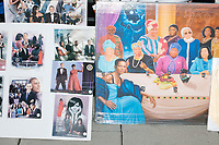 A sidewalk vendor sold photos and paintings featuring Barack and Michelle Obama alongside other historic black figures as people gathered in the National Mall area of Washington, DC, for the Women's March on Washington protest and demonstration in opposition to newly inaugurated President Donald Trump on Jan. 21, 2017.