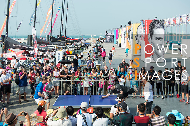 Visitors enjoy the entertainment activities at the village during the Volvo Ocean Race Leg 3 Abu Dhabi-Sanya on February 6, 2015 in Sanya, China. The Volvo Ocean Race 2014-15 is the 12th running of this ocean marathon. Starting from Alicante in Spain on October 11, 2014, the route, spanning some 39,379 nautical miles, visits 11 ports in 11 countries (Spain, South Africa, United Arab Emirates, China, New Zealand, Brazil, United States, Portugal, France, the Netherlands and Sweden) over nine months. The Volvo Ocean Race is the world's premier ocean race for professional racing crews. Photo by Victor Fraile / Power Sport Images