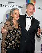 Bill Irwin and Martha Roth arrive for the formal Artist's Dinner honoring the recipients of the 2014 Kennedy Center Honors hosted by United States Secretary of State John F. Kerry at the U.S. Department of State in Washington, D.C. on Saturday, December 6, 2014. The 2014 honorees are: singer Al Green, actor and filmmaker Tom Hanks, ballerina Patricia McBride, singer-songwriter Sting, and comedienne Lily Tomlin.<br /> Credit: Ron Sachs / Pool via CNP