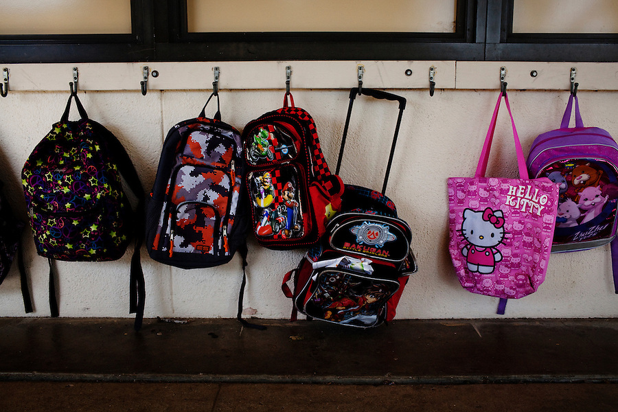 Oceano, California, November 1, 2011 - A collection of school bags hang outside a classroom  at the Oceano Elementary School. As a part of an effort to help bridge some of the contrasts in school performance here, the 10,800-student school district of Lucia Mar recently became the first in California to adopt, in four of its schools, the Teacher Advancement Program (TAP) school-reform initiative. The complex model couples professional development, teacher observations keyed to a set of teaching standards and  leadership opportunities for teachers. .
