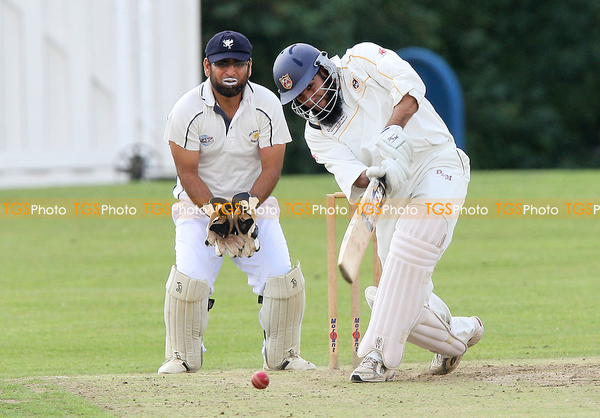 I Shah in batting action for Hainault as F Butt looks on from behind the stumps - Ardleigh Green CC vs Hainault & Clayhall CC - Essex Cricket League at Central Park - 08/08/09 - MANDATORY CREDIT: Gavin Ellis/TGSPHOTO - Self billing applies where appropriate - Tel: 0845 094 6026