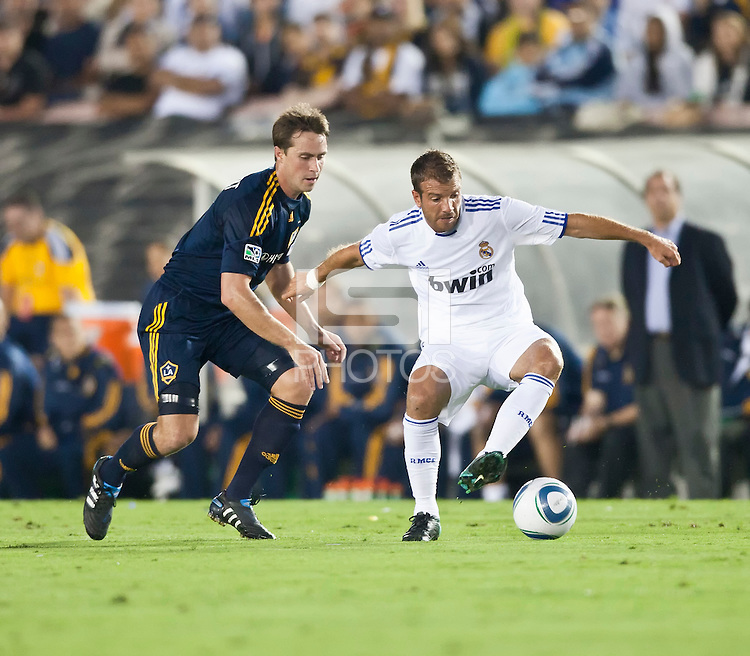 Real midfielder Rafael van der Vaart (23) makes a move against Galaxy defender Todd Dunivant (2) during the first half of the friendly game between LA Galaxy and Real Madrid at the Rose Bowl in Pasadena, CA, on August 7, 2010. LA Galaxy 2, Real Madrid 3.