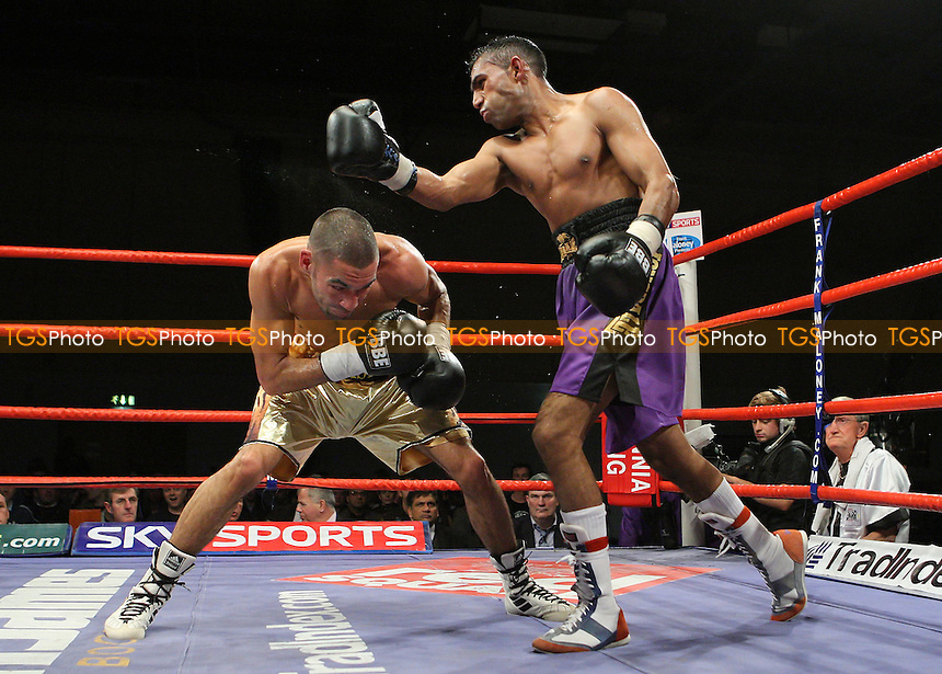 Akaash Bhatia (Harrow, gold shorts) defeats Riaz Durgahed (Bristol, purple shorts) in a Featherweight contest at Newham Leisure Centre, promoted by Frank Maloney - 30/11/07 - MANDATORY CREDIT: Gavin Ellis/TGSPHOTO. Self-Billing applies where appropriate. NO UNPAID USE. Tel: 0845 094 6026